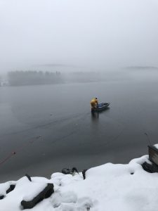 John Cooley heading out in a boat on the ice to rescue Loon